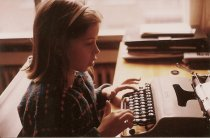 Me, writing god knows what at 8 or 9 years old